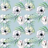 Seamless pattern with watercolor white anemones and green palm leaves. Hand drawn on a blue background Stock Images