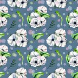 Seamless pattern with watercolor white anemones and green tropic leaves. Hand drawn on a blue background Royalty Free Stock Image