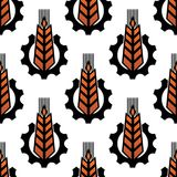 Seamless pattern of wheat with gear wheels Royalty Free Stock Photo