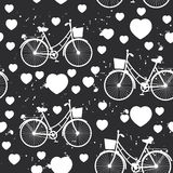 Seamless pattern white bike and heart on black background. Vector Stock Images