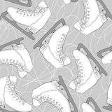 Seamless pattern with white figure skates. Royalty Free Stock Image