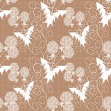 Seamless pattern with white flowers beige background. In specks Royalty Free Stock Images