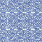 Seamless pattern with white flowers and butterflies. On a blue background Stock Photography
