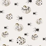 Seamless pattern with white Halloween pumpkins carved faces and spider on light background. vector illustration