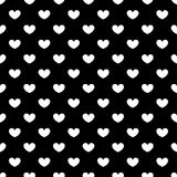 Seamless pattern of white hearts on a black background. Royalty Free Stock Photos