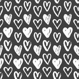 Seamless pattern of white hearts on black Royalty Free Stock Photo