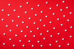 Seamless pattern. White hearts on red background. Top view. Valentine`s Day. Love, date, romantic concept royalty free stock images