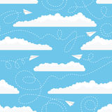 Seamless pattern with white paper airplanes and clouds. Vector seamless pattern with white paper airplanes flying among white clouds in the blue sky Royalty Free Stock Photos