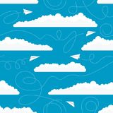 Seamless pattern with white paper airplanes and clouds. Vector seamless pattern with white paper airplanes flying among white clouds in the blue sky Stock Image