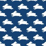 Seamless pattern with white rabbits. Vector background with running rabbits for design Stock Photos