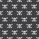 Seamless pattern white skulls with bones on a black background. Vector Illustration Royalty Free Stock Images