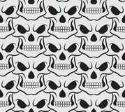 Seamless pattern with white skulls Royalty Free Stock Photos