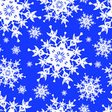 Seamless pattern with white snowflakes. Beautiful seamless pattern with white ornate snowflakes. Winter blue seamless wallpaper for New Year and Christmas Royalty Free Stock Photos
