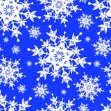 Seamless pattern with white snowflakes Royalty Free Stock Photos