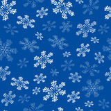 Seamless pattern with white snowflakes. Blue seamless pattern with white snowflakes Royalty Free Stock Image