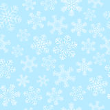 Seamless pattern with white snowflakes. On blue Stock Images