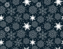 Seamless pattern of white snowflakes on a blue background. Seamless pattern of snowflakes on a blue background Royalty Free Stock Photo