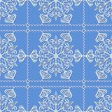 Seamless pattern with white snowflakes. On a blue background Vector Illustration