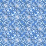 Seamless pattern with white snowflakes Stock Photo