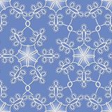 Seamless pattern with white snowflakes. On a blue background Royalty Free Illustration