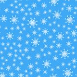 Seamless pattern. White snowflakes on a blue backgrounds. For packaging paper royalty free illustration