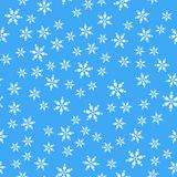 Seamless pattern. White snowflakes on a blue backgrounds. For packaging paper stock illustration