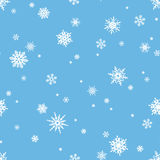 Seamless pattern with white snowflakes on blue. Vector illustration. Vector seamless pattern with white snowflakes on a blue background Royalty Free Stock Images