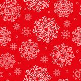 Seamless pattern with white snowflakes and red background Stock Images
