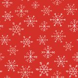 Seamless pattern with white snowflakes on a red background. Cute doodle snowflakes vector illustration