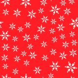 Seamless pattern. White snowflakes on a red backgrounds. For packaging paper royalty free illustration