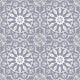 Seamless pattern with white snowflakes. On a gray background Stock Illustration