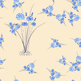 Seamless pattern of wild small blue flowers and bouquet on a pink background. Watercolor. Stock Images
