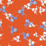 Seamless pattern of wild small white and blue flowers and bouquet on a red background. Watercolor. Stock Photos