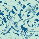 Seamless pattern of winter clothes and skates Stock Images