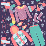 Seamless pattern with winter clothing. Warm woollies. Clothes for cold weather Royalty Free Stock Images