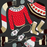 Seamless pattern with winter clothing. Warm woollies. Clothes for cold weather Royalty Free Stock Photo