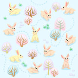 Seamless pattern of winter forest with rabbits between trees Stock Photos