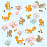 Seamless pattern of winter forest with squirrels between trees Stock Photo