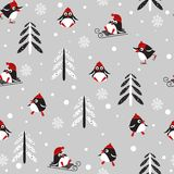 Seamless background with penguins and trees. Seamless pattern with Winter Holidays cute vector penguins in a red hat on a light gray background. Vector Royalty Free Stock Images