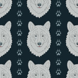 Seamless pattern with wolves and traces Stock Images