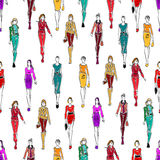 Seamless pattern of women in fashionable clothes Stock Photos