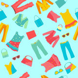 Seamless pattern with women's clothing and accessories Stock Photos