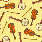 Seamless Pattern with Wooden Fiddle and Banjo. Seamless Vector Pattern. Wooden Fiddle or Violin with Fiddlestick and Banjo on a Yellow Background Royalty Free Stock Photography