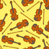 Seamless Pattern with Wooden Fiddle or Violin. Seamless Vector Pattern with Wooden Fiddle or Violin and Fiddlestick on a Yellow Background Royalty Free Stock Photos
