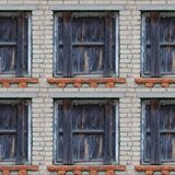 Seamless pattern of wooden window shutters. Seamless pattern for designers with old wooden window shutters on grey brick wall royalty free stock images