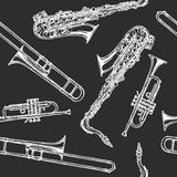 Seamless pattern with woodwind and brass musical instrument. Vector illustration in vintage engraved style on black background Royalty Free Stock Photos
