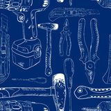 Seamless pattern, working tools in sketch style. Blue background Royalty Free Stock Image