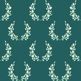 A seamless pattern with the wreaths of the tender green roses, painted in a watercolor on a dark green background Royalty Free Stock Image