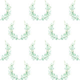 A seamless pattern with the wreaths of the tender green roses, painted in a watercolor on a white background Stock Photos