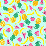 Seamless pattern with yellow bananas, pineapples and juicy strawberries on mint green background.  Royalty Free Stock Images